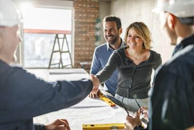 Woman and Man Greeting Contractors for Home Repair